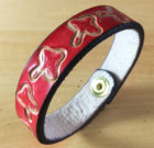 Toadstools on handmade red leather bangle